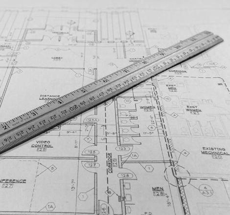 An image of some blueprints with a ruler.